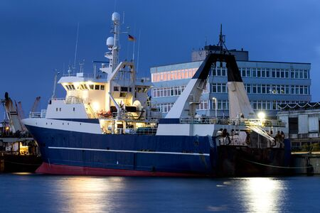 fishing vessel in port at nightfall
