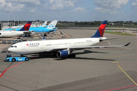 Delta Air Lines Airbus A330-200 with registration N860NW on pushback at Amsterdam Airport Schiphol.