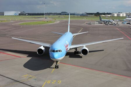 Dutch Arkefly Boeing 767-300 with registration PH-AHQ taxiing to gate at Amsterdam Airport Schiphol.