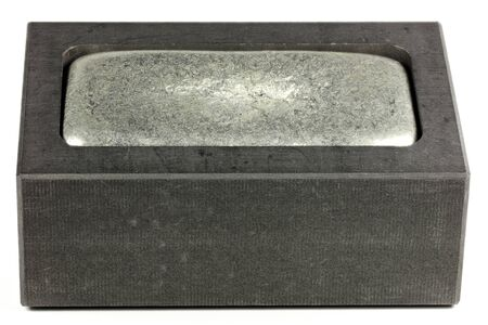 graphite mold with zinc bar isolated on white background