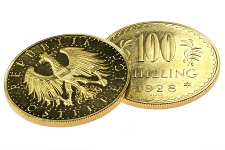 Austrian 100 Schilling gold coins isolated on white background