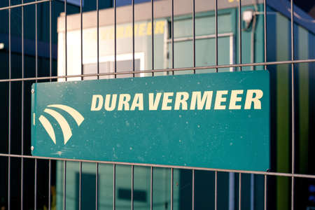 Dura Vermeer sign at construction site fence. Dura Vermeer is active in construction, infrastructure, engineering and services. Éditoriale