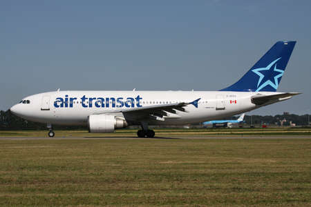 Canadian Air Transat Airbus A310-300 with registration C-GTSY rolling on taxiway V of Amsterdam Airport Schiphol.