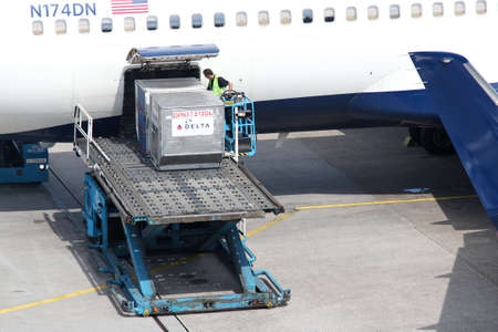 Unit load devices being loaded into Delta Air Lines Boeing 767 at Amsterdam Airport Schiphol. Editorial