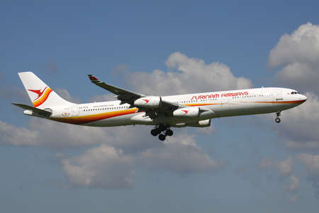 Surinam Airways Airbus A340-300 with registration PZ-TCP on short final for Amsterdam Airport Schiphol.