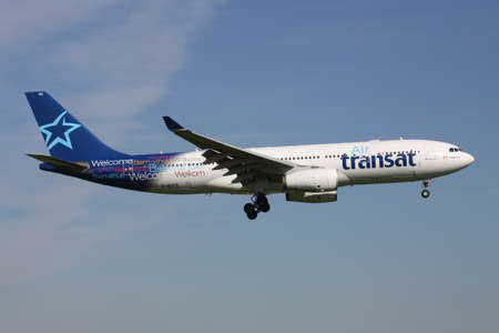 Canadian Air Transat Airbus A330-200 with registration C-GITS on short final for Amsterdam Airport Schiphol.
