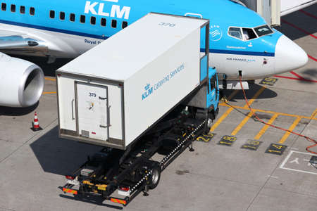 KLM Catering Services truck serving KLM Boeing 737 at Amsterdam Airport Schiphol. Editorial