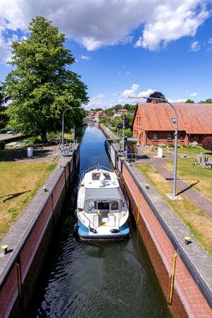 motorboat in the river Elde lock in Plau am See, Germany