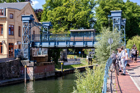 Lift bridge in Plau am See, Germany. It is a steel lift bridge that was built in 1916. With a lifting height of up to 1.86 m, it is the highest lifting bridge in Mecklenburg.