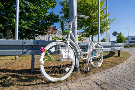 Ghost bike at guardrail. A ghost bike is a bicycle roadside memorial, placed where a cyclist has been killed or severely injured, usually by a motor vehicle.
