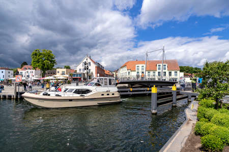 motorboat passing the swing bridge in Malchow, Germany