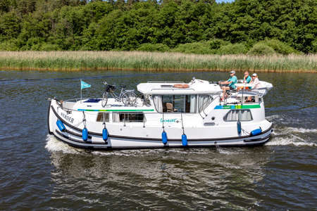 Locaboat houseboat WERDER on the river Elde in the Mecklenburg Lake District, Germany Éditoriale