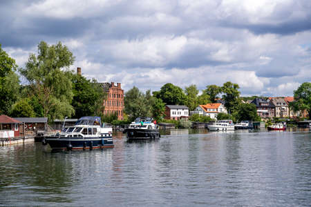queue of motorboats on Lake Malchow in the Mecklenburg Lake District, Germany