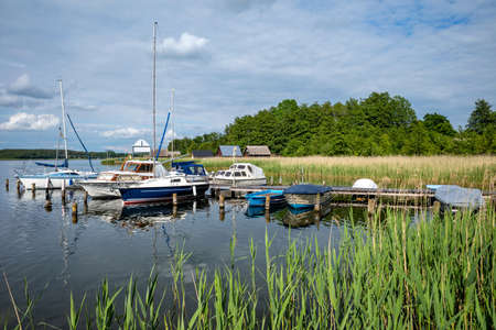 jetty with boats at Lake Krakow in the Mecklenburg Lake District, Germany