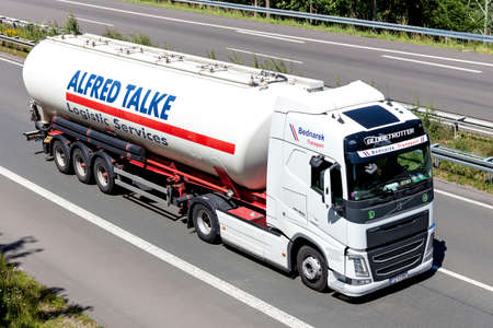 Bednarek Volvo FH truck with Alfred Talke silo trailer on motorway.