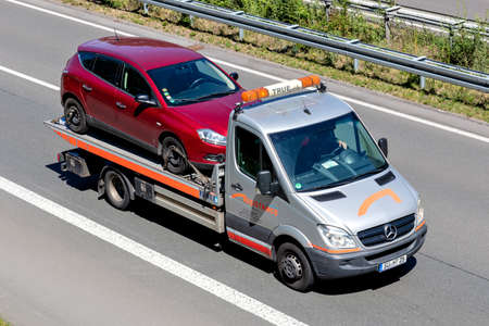 Assistance Partner flatbed recovery vehicle on motorway. Assistance Partner is the second largest provider of breakdown and accident assistance in Germany.