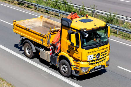 Berster Mercedes-Benz Arocs three-way tipper truck on motorway.