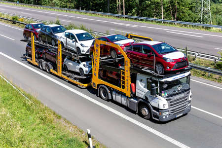 Auto-Trans Scania P410 car-carrying truck on motorway.