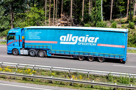 allgaier MAN TGX truck with curtainside trailer on motorway. Editoriali