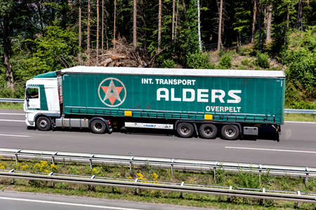 Alders Overpelt DAF XF truck with curtainside trailer on motorway. Editoriali