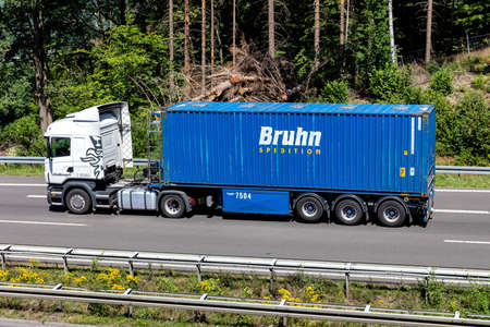 Schollmeyer Scania truck with Bruhn container on motorway.