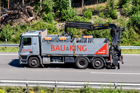 BAUKING truck on motorway. BAUKING is one of the market leaders in the German building materials and timber trade.