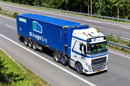 De Jong-Grauss Volvo FH truck with BG Freight Line container on motorway.