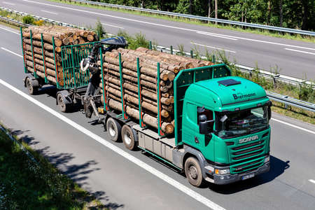Biermann Scania G450 logging truck on motorway.