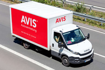 Iveco Daily of Avis on motorway. Avis is an American car rental company headquartered in Parsippany, New Jersey, United States. Editoriali