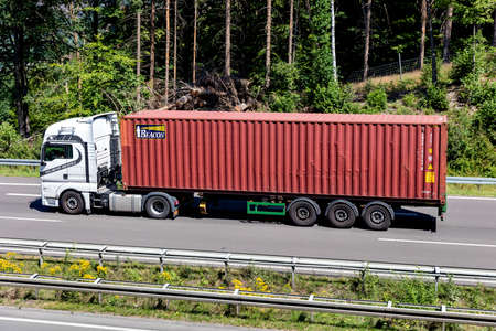 Kollmeyer MAN truck with Beacon container on motorway.