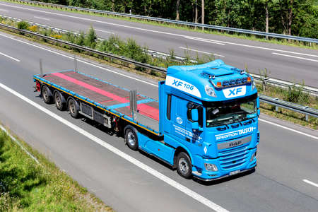 Busch DAF XF flatbed truck on motorway. Editoriali