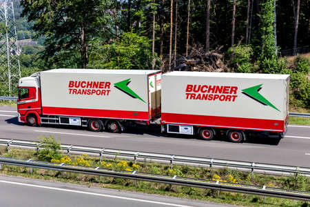 Buchner Transport temperature controlled combination truck on motorway.
