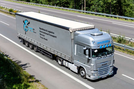 Celtrans DAF XF truck with curtainside trailer on motorway.