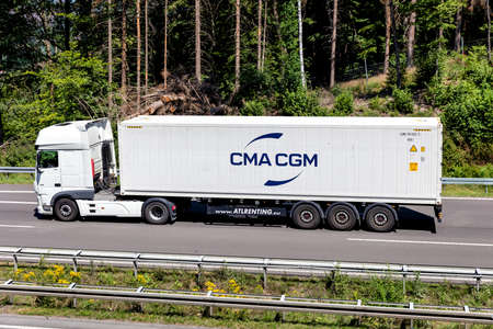 DAF XF truck with CMA CGM container on motorway. Editoriali