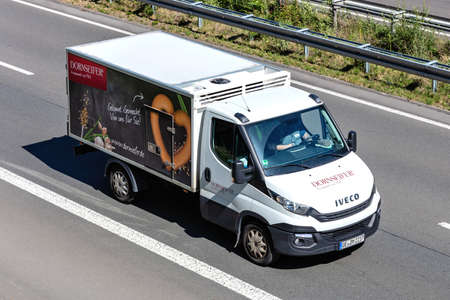 Dornseifer refrigerated Iveco Daily van on motorway. Redakční