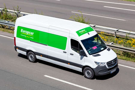 Europcar Mercedes-Benz Sprinter on motorway. Europcar Mobility Group is a French car rental company founded in 1949 in Paris.