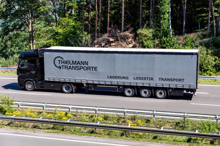 Thielmann Mercedes-Benz Actros truck with curtainside trailer on motorway.