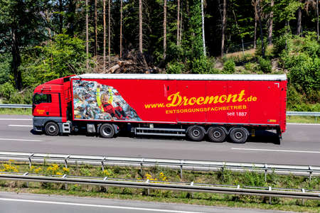 Droemont MAN TGX truck with bulk trailer on motorway.