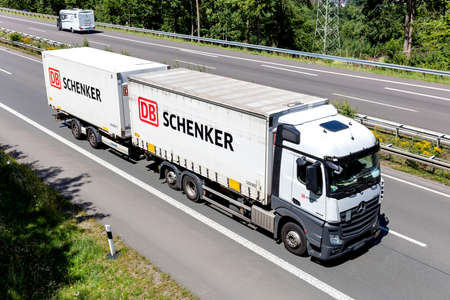 DB Schenker Mercedes-Benz Actros combination truck on motorway. Editoriali