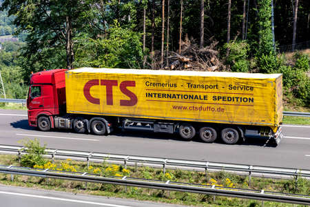 Robert Nauels truck with CTS tarpaulin trailer on motorway.