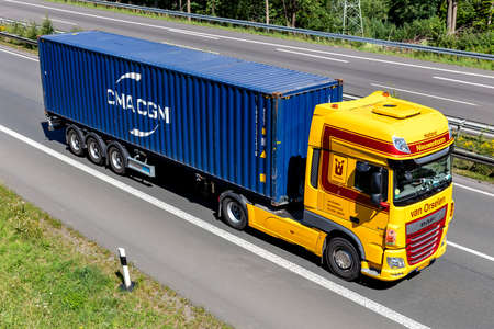 van Orselen DAF XF truck with CMA CGM container on motorway. Editoriali