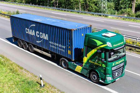 SJegers DAF XF truck with CMA CGM container on motorway. Archivio Fotografico - 154912710