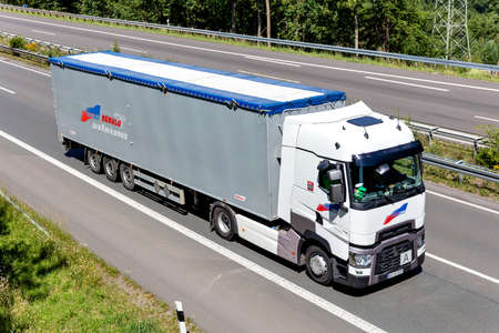 Coquelle Renault truck with bulk trailer on motorway.