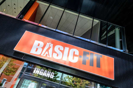 Basic-Fit sign at fitness club. Basic-Fit is the European market leader in the value-for-money fitness market.
