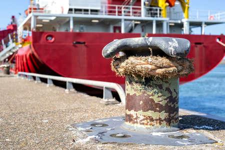 cargo ship fixed at iron bollard