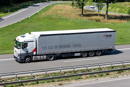 Smidl Mercedes-Benz Actros truck with curtainside trailer on motorway.