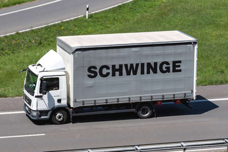 Schwinge MAN TGL truck on motorway.