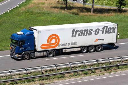 Winkler Scania R410 truck with temperature controlled trans-o-flex trailer on motorway.