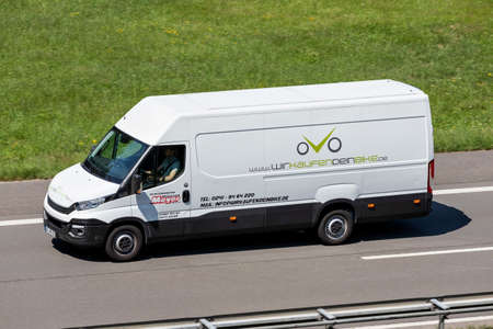 Motorrad Meyer Iveco Daily van on motorway. Editoriali