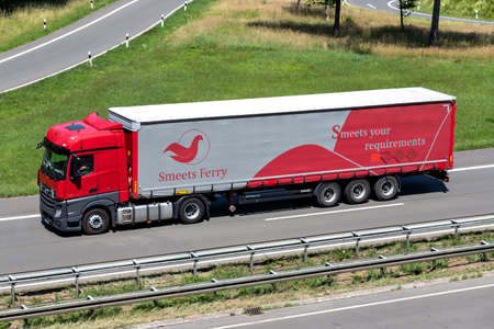 Smeets Ferry Mercedes-Benz Actros truck with curtainside trailer on motorway. Archivio Fotografico - 156209900